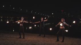 Skillful fireshow performers spinning staves stock video