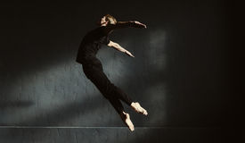 Skillful flexible dancer performing in the air Stock Image