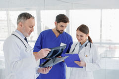 Skillful general practitioners working with documents Stock Photo