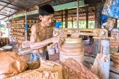 Skillful hands potter at work shaping ceramic products Royalty Free Stock Image