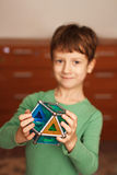 Skillful little boy holding toy Stock Image