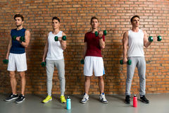 Skillful male athletes lifting weights Royalty Free Stock Photos