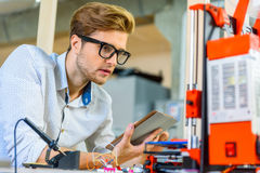Skillful male engineer using 3d printing Royalty Free Stock Photo