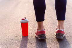 Skillful male runner stands near drink Stock Images
