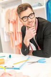 Skillful male tailor designing cloth in atelier Stock Photo
