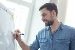 Skillful male worker is making notes Stock Photography