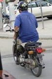 Skillful motorbike driver. Phnom Penh, Cambodia - April 25, 2014: Skillful motorbike driver on the streets of Phnom Penh, Cambodia Stock Photo