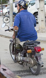 Skillful motorbike driver. Phnom Penh, Cambodia - April 25, 2014: Skillful motorbike driver on the streets of Phnom Penh, Cambodia Royalty Free Stock Image