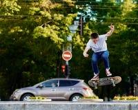 Skillful skateboarder jumping Stock Photos