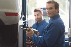 Skillful specialist changing the tires Stock Photo