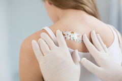 Skillful specialist examining patient back in the clinic Royalty Free Stock Photos
