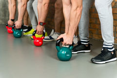 Skillful sportsmen training with weights Stock Image