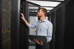 Skillful IT technician establishing connection stock photography