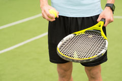 Skillful tennis player carrying the equipment Royalty Free Stock Photos