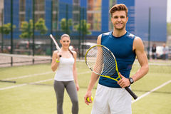 Skillful two athletes playing tennis together royalty free stock image