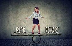 Skillful young business woman balancing between reward and risk royalty free stock images