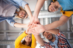 Skillful young colleagues are happy to be together Royalty Free Stock Images