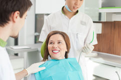 Skillful young orthodontist is working with a patient Stock Image