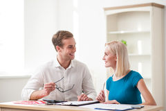 Skillful young realtor made a deal with customer Stock Photography