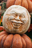Skillfully carved head of pumpkins, decorations for the autumn holidays Royalty Free Stock Photos