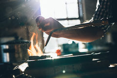 Skillfully melting metal for a new jewelry design Stock Images