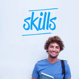 Skills against happy student holding book. The word skills against happy student holding book Royalty Free Stock Image