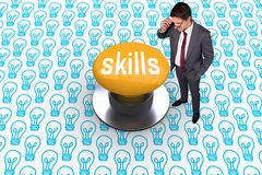 Skills against yellow push button Royalty Free Stock Image