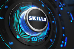Skills Button with Glowing Blue Lights. On Black Console Royalty Free Stock Images