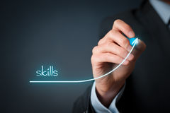 Skills improvement. Concept. Businessman draw rising curve of skills Stock Photos