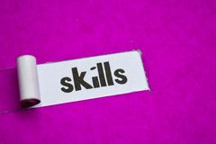Skills text, Inspiration, Motivation and business concept on purple torn paper stock photo