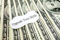 Skills Upgrade. Upgrade Your Skills message on hundred dollar bills Stock Photo