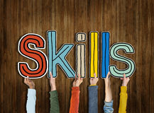 Skills Word Concepts. Diverse Hands Holding The Word Skills Royalty Free Stock Image