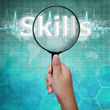 Skills , word in Magnifying glass , background medical Royalty Free Stock Photography