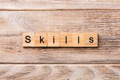 Skills word written on wood block. Skills text on wooden table for your desing, concept.  stock images