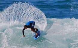 Skim Boarder riding a shore break wave at Aliso Beach in Laguna Beach, California. Image shows a skim boarder riding a shore break wave Aliso Beach in Laguna Stock Image