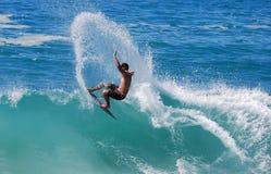 Skim Boarder riding a shore break wave at Aliso Beach in Laguna Beach, California. Image shows a skim boarder riding a shore break wave Aliso Beach in Laguna Stock Photo