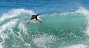 Skim Boarder riding a shore break wave at Aliso Beach in Laguna Beach, California. Stock Photo