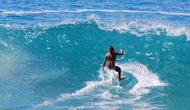 Skim Boarder riding a shore break wave at Aliso Beach in Laguna Beach, California. Stock Photos