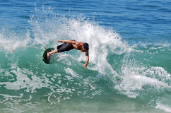Skim boarder riding wave at Brooks Street Beach, Laguna Beach, CA Royalty Free Stock Images