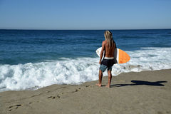 Skim Boarder waiting for a shore break wave to ride at Aliso Beach in Laguna Beach, California. Stock Photography