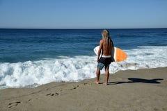 Skim Boarder waiting for a shore break wave to ride at Aliso Beach in Laguna Beach, California. Stock Photography