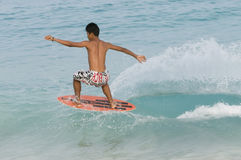 Skim boarding. Picture of a man skim boarding Stock Photography
