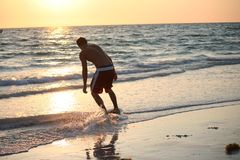 Skim Boarding at Sunset Royalty Free Stock Photo