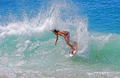 Skimboarder at Aliso Beach, Laguna Beach, CA Stock Images