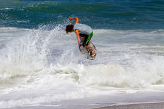 Skimboarder Competes Stock Photo