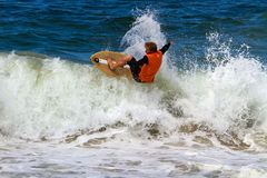 Skimboarder Competes Stock Images