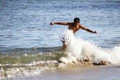 Skimboarder. In Santa Barbara, CA August 2014 enjoying the surf Royalty Free Stock Photos