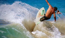 Skimboarding at Big Beach. A man skimboarding at Big Beach in Maui Hawaii. Skimboarding originated in Southern California when lifeguards wanted an easy way to Royalty Free Stock Images