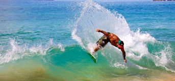 Skimboarding at Big Beach. A man skimboarding at Big Beach in Maui Hawaii. Skimboarding originated in Southern California when lifeguards wanted an easy way to Stock Image