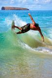 Skimboarding at Big Beach. A man skimboarding at Big Beach in Maui Hawaii. Skimboarding originated in Southern California when lifeguards wanted an easy way to Royalty Free Stock Photography